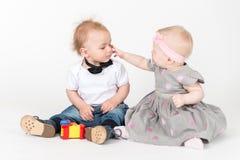 Two sitting kids Stock Photos