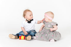 Two sitting kids Stock Photography