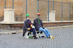 Two sitting men Stock Photos