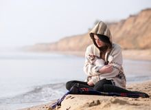 Two sitting by the seashore Royalty Free Stock Image