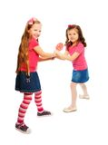 Fighting over lollipop Royalty Free Stock Photos