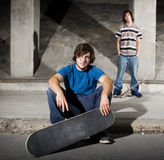 Two skateboarders posing for camera Stock Images