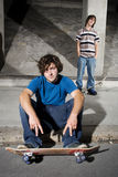 Two skateboarders in underground parking lot Stock Photo