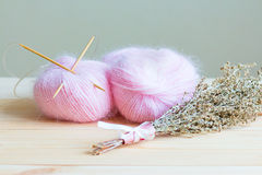 Two skeins of pink yarn Stock Photo