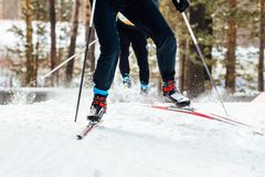 Two skiers downhill skiing stock image