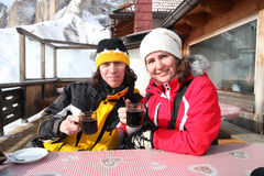Two skiers drink mulled wine Stock Photography