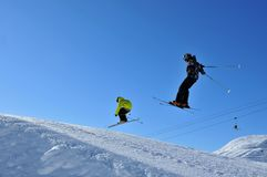 Two skiers jumping together Royalty Free Stock Photo