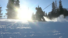 Two skiers skiing slope on winter day stock video