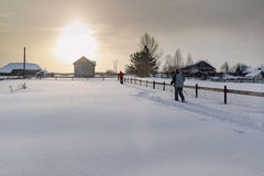 Two skiers skiing on the snow-covered yard. Village Visim, Russia Royalty Free Stock Photo