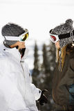 Two Skiers Smiling at Each Other Royalty Free Stock Image