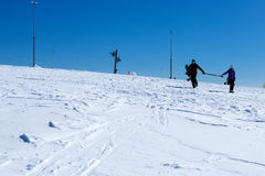 Two skiers on the top of mountain Stock Photo