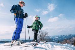 Two skiers on the top of snow hill ready to slow down Royalty Free Stock Photos