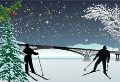 Two skiers under night sky Royalty Free Stock Photography