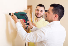Two skilled men doing maintenance. Two adult skilled men doing maintenance work at home Stock Image