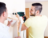 Two skilled men doing maintenance Royalty Free Stock Photo