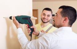 Two skilled men doing maintenance Stock Image