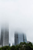 Two Skiyscrapers Rising Into Heavy Fog Stock Photography