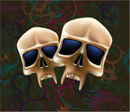 Two skulls. Mask a skull with dark blue eyes Royalty Free Stock Photos