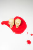 TWO SKULLS HEAD ON RED BLOOD HALLOWEEN FESTIVAL. Royalty Free Stock Photo