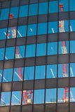 Two sky scrapers reflected. Two skyscrapers on Hakata station in Fukuoka, Japan, reflected in the windows of a tall building stock photos