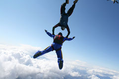 Two skydivers exit an airplane Royalty Free Stock Image