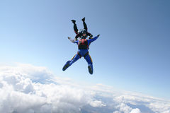 Two skydivers exit an airplane. High up in the air Royalty Free Stock Photography