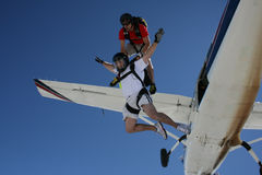 Two skydivers exit an airplane. From 12000 feet Royalty Free Stock Image
