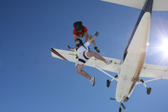 Two skydivers exit an airplane. 12000 feet in the air Stock Photos