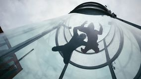 Two skydivers fly into wind tunnel. Extreme skydiving tandem in wind tunnel royalty free stock photos