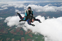 Two skydivers in freefall. Two skydivers having fun while in freefall Royalty Free Stock Image
