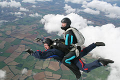 Two skydivers in freefall. Two skydivers having fun while in freefall Royalty Free Stock Photos