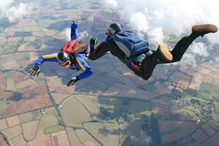 Two skydivers in freefall. On a sunny day Stock Images