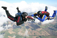 Two skydivers in freefall. On a sunny day Stock Photo