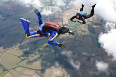 Two skydivers in freefall. On a sunny day Royalty Free Stock Photo