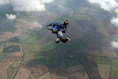 Two skydivers in freefall. Doing formations Royalty Free Stock Photo