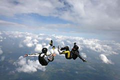 Two skydivers in freefall. Two skydivers in a sit position while in freefall Stock Photography