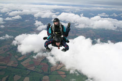 Two skydivers having fun. While in freefall Stock Photo