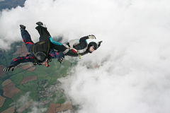 Two skydivers having fun. While in freefall Stock Photos