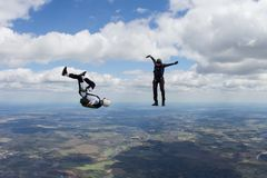 Two skydivers are having fun in the sky. stock photo