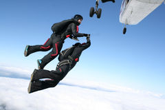 Two skydivers jump from a plane Stock Images