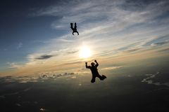 Skydiving. Two skydivers are in the sky. royalty free stock photography