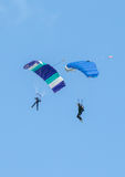 Two skydivers performing skydiving with parachutes Stock Photos