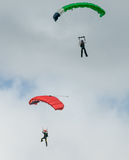 Two skydivers performing skydiving with parachutes Stock Image