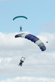 Two skydivers performing skydiving with parachutes Royalty Free Stock Images