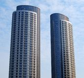 Two skyscrapers. Against blue sky Stock Photos