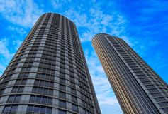 Two skyscrapers. Against blue sky Stock Photography