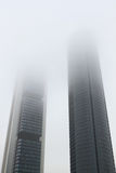 Two skyscrapers in polluted gases city. Stock Images