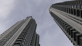 Two skyscrapers under the blue sky. stock footage