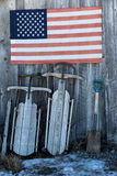 Two sleds and an American flag stock photos