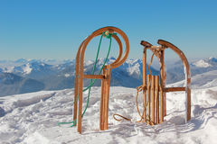 Two sleds and wintry mountain range stock photo